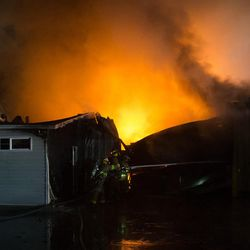 Firefighters battle a blaze at the Sandy Public Works Building in Sandy on Friday, Jan. 27, 2017.