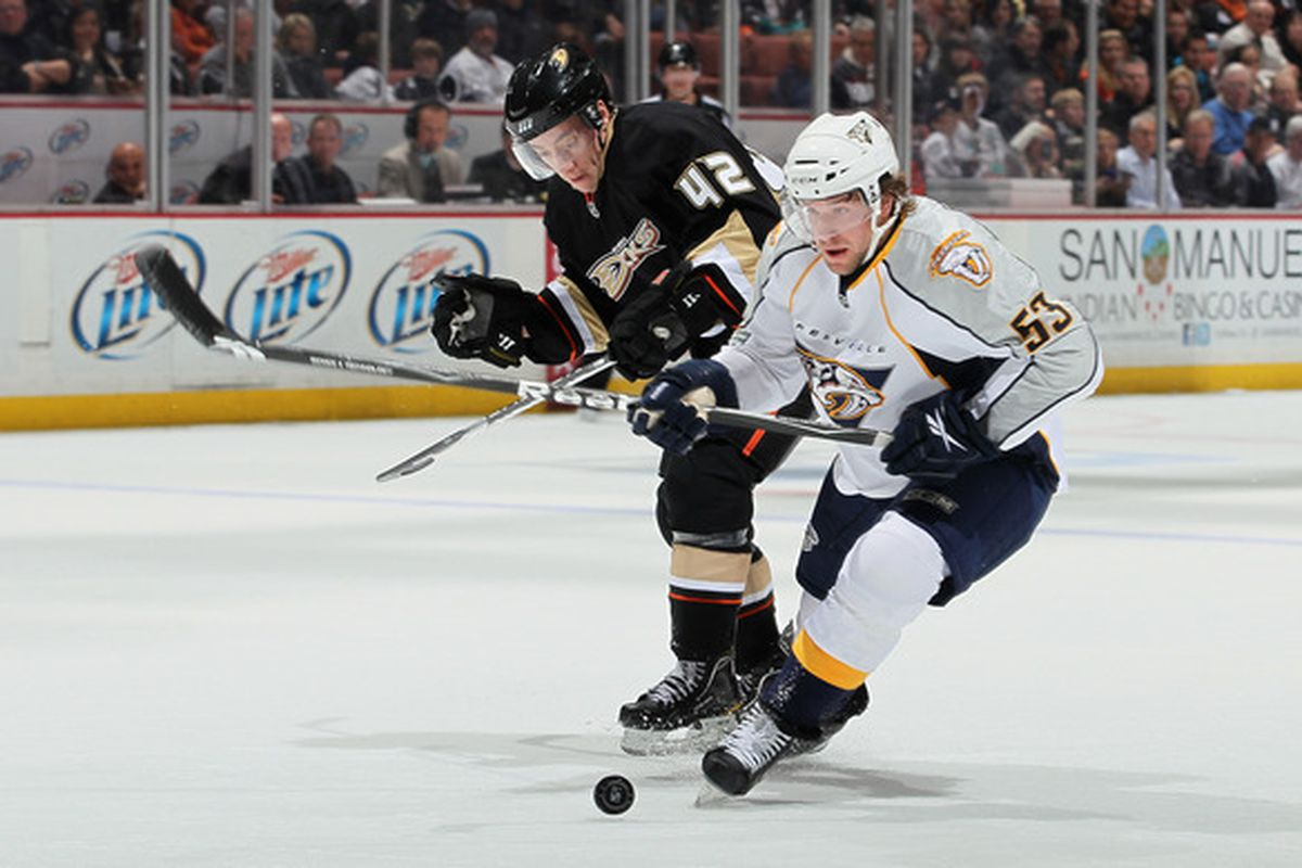 ANAHEIM CA - JANUARY 05:  Dan Sexton #42 of the Anaheim Ducks and Chris Mueller #53 of the Nashville Predators battle for the puck in the second period at the Honda Center on January 5 2011 in Anaheim California.  (Photo by Jeff Gross/Getty Images)