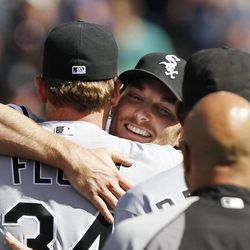 Chicago White Sox starting pitcher Philip Humber, center, is mobbed by teammates after pitching a perfect baseball game against the Seattle Mariners, Saturday, April 21, 2012, in Seattle. The White Sox won 4-0.