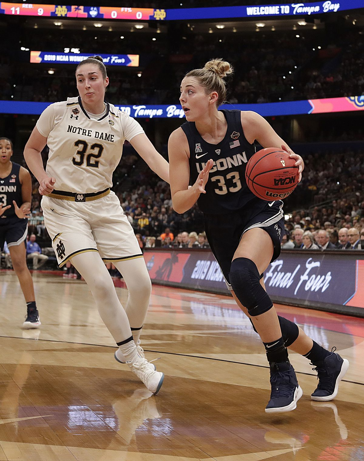 Connecticut guard Katie Lou Samuelson (33) looks to pass as Notre Dame forward Jessica Shepard (32) defends during the first half of a women's Final Four NCAA college basketball semifinal tournament game, Friday, April 5, 2019, in Tampa, Fla. | John Raoux