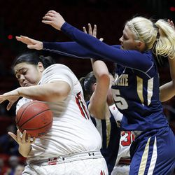 Utah Utes center Joeseta Fatuesi (33) pulls in a rebound against Montana State Bobcats forward Riley Nordgaard (15) at right during NIT women's basketball action in Salt Lake City, Friday, March 18, 2016.