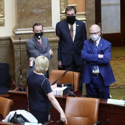 Legislators greet each other in the House of Representatives before the opening of a special session to deal with myriad COVID-19 budget changes at the Capitol in Salt Lake City on Thursday, June 18, 2020.