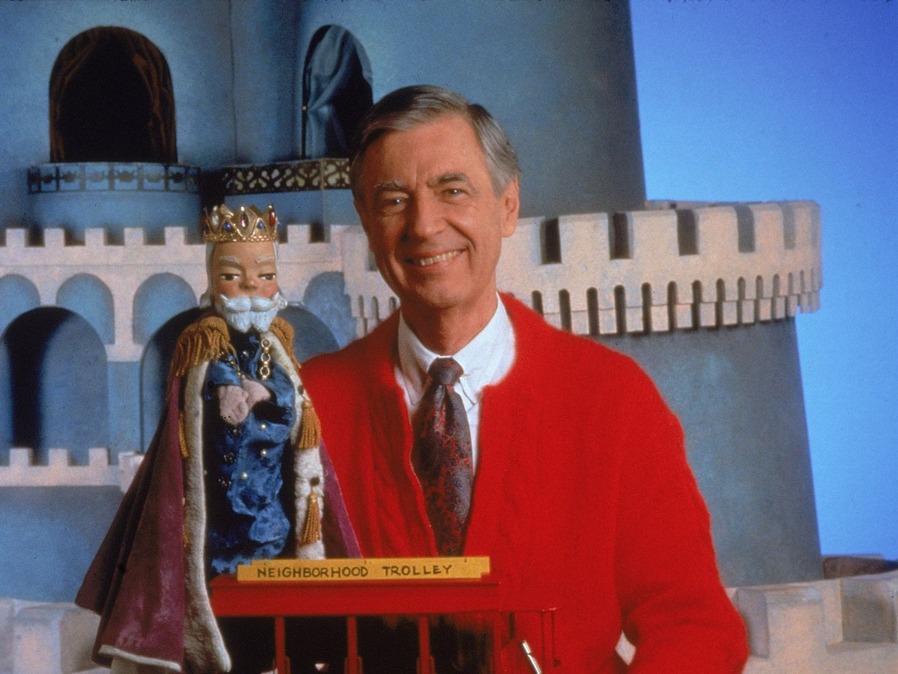 Fred Rogers, host of Mister Rogers' Neighborhood, poses with the famous King Friday puppet from his show.