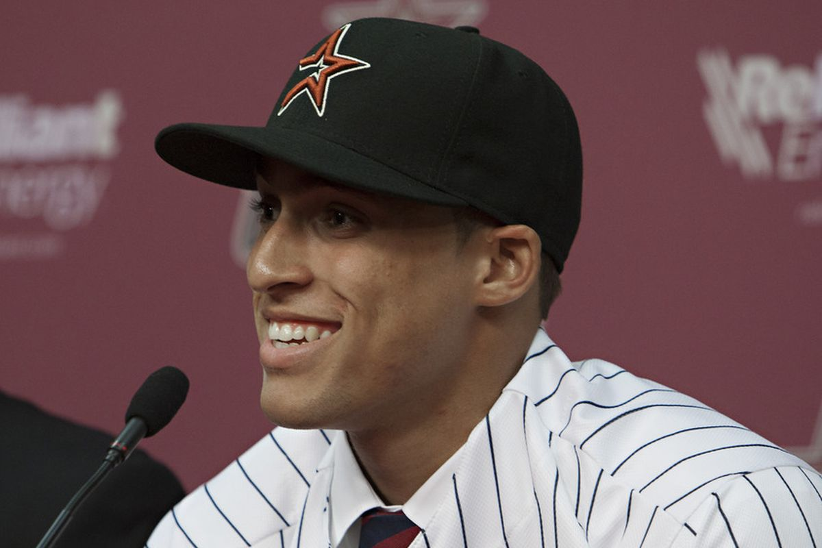 George Springer should be up with the Astros by the all-star break.