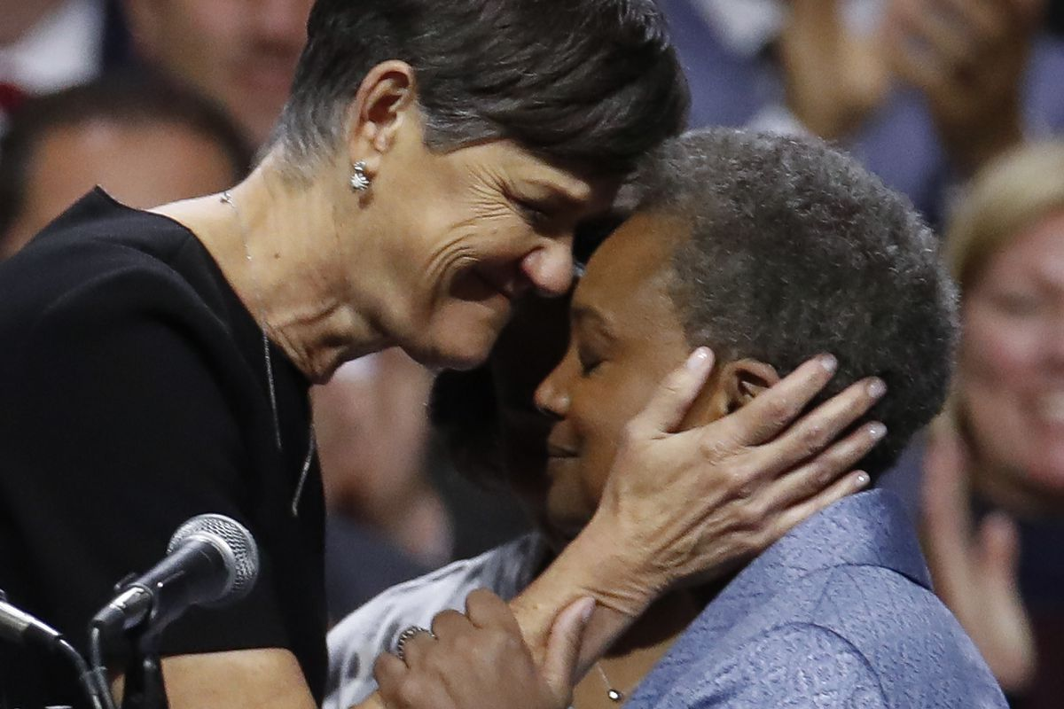 Mayor Lori Lightfoot embraces her wife Amy Eshleman at the mayor's inauguration ceremony on May 20.