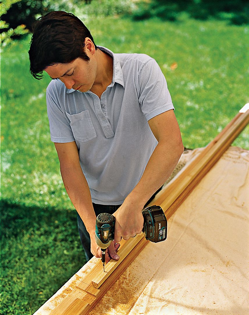 Man Assembles Trellis Frame With Drill