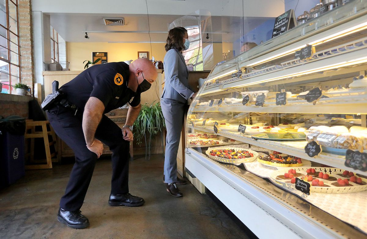 Salt Lake Police Chief Mike Brown, left, and Salt Lake City Erin Mendenhall order pastries at Carlucci's Bakery following a press conference about the city's crime rates on Tuesday.