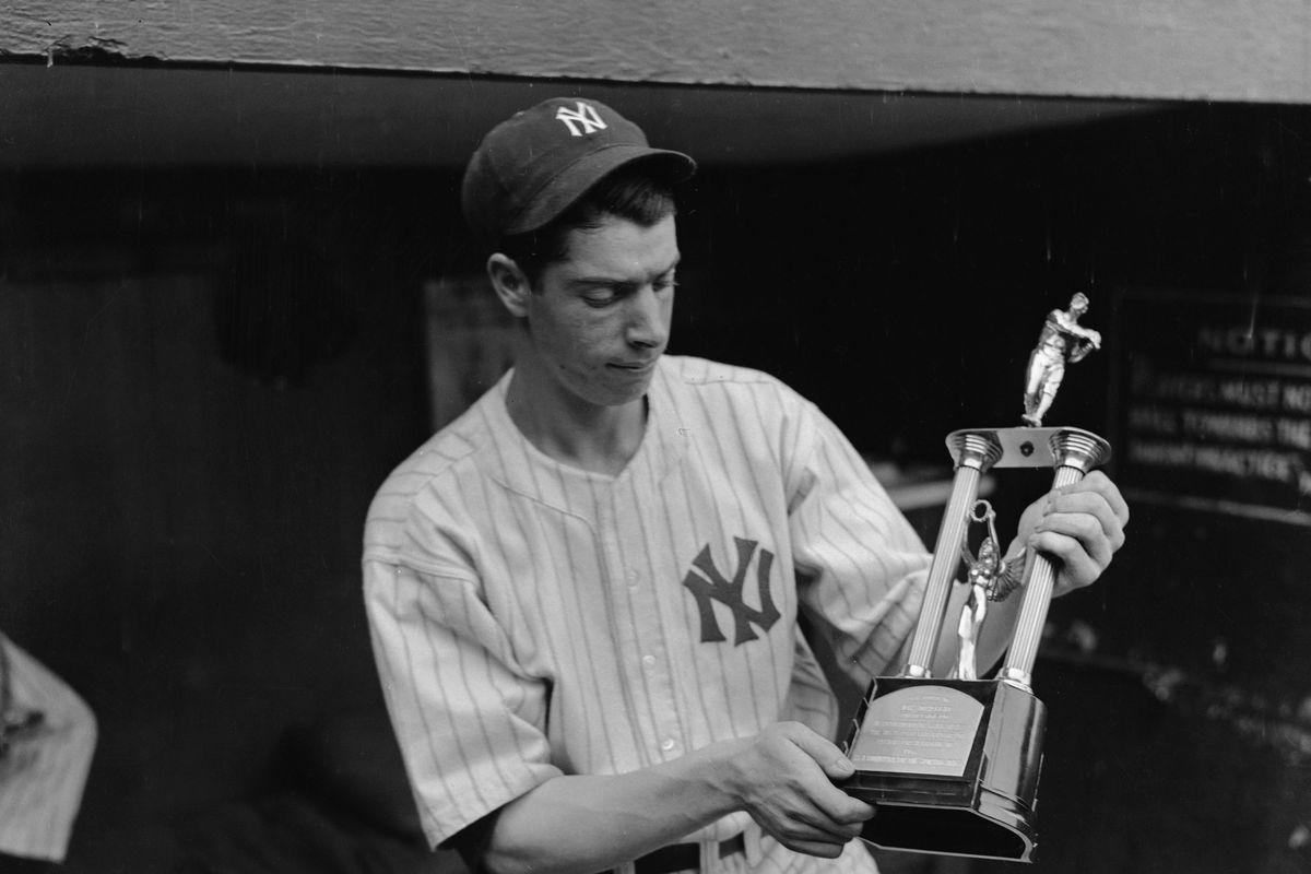 Joe DiMaggio Holding a Trophy
