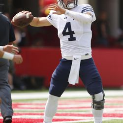 Brigham Young Cougars quarterback Taysom Hill (4)  warms up prior to the BYU and Nebraska football game in Lincoln, Nebraska, Saturday, Sept. 5, 2015.