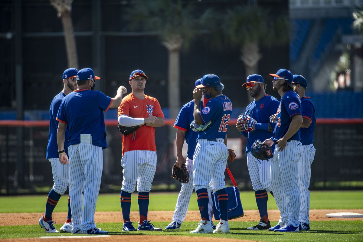 New York Mets' Dominic Smith shares a laugh with teammates at spring training in 2021