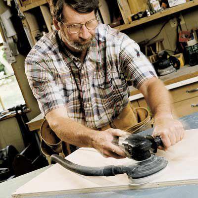 Man Sanding Wood With Random Orbit Sander