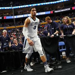 Villanova guard Josh Hart (3) walks back to the court after crashing into the Villanova band section chasing a ball during the second half of a first-round men's college basketball game against Mount St. Mary's in the NCAA Tournament, Thursday, March 16, 2017, in Buffalo, N.Y. (AP Photo/Bill Wippert)