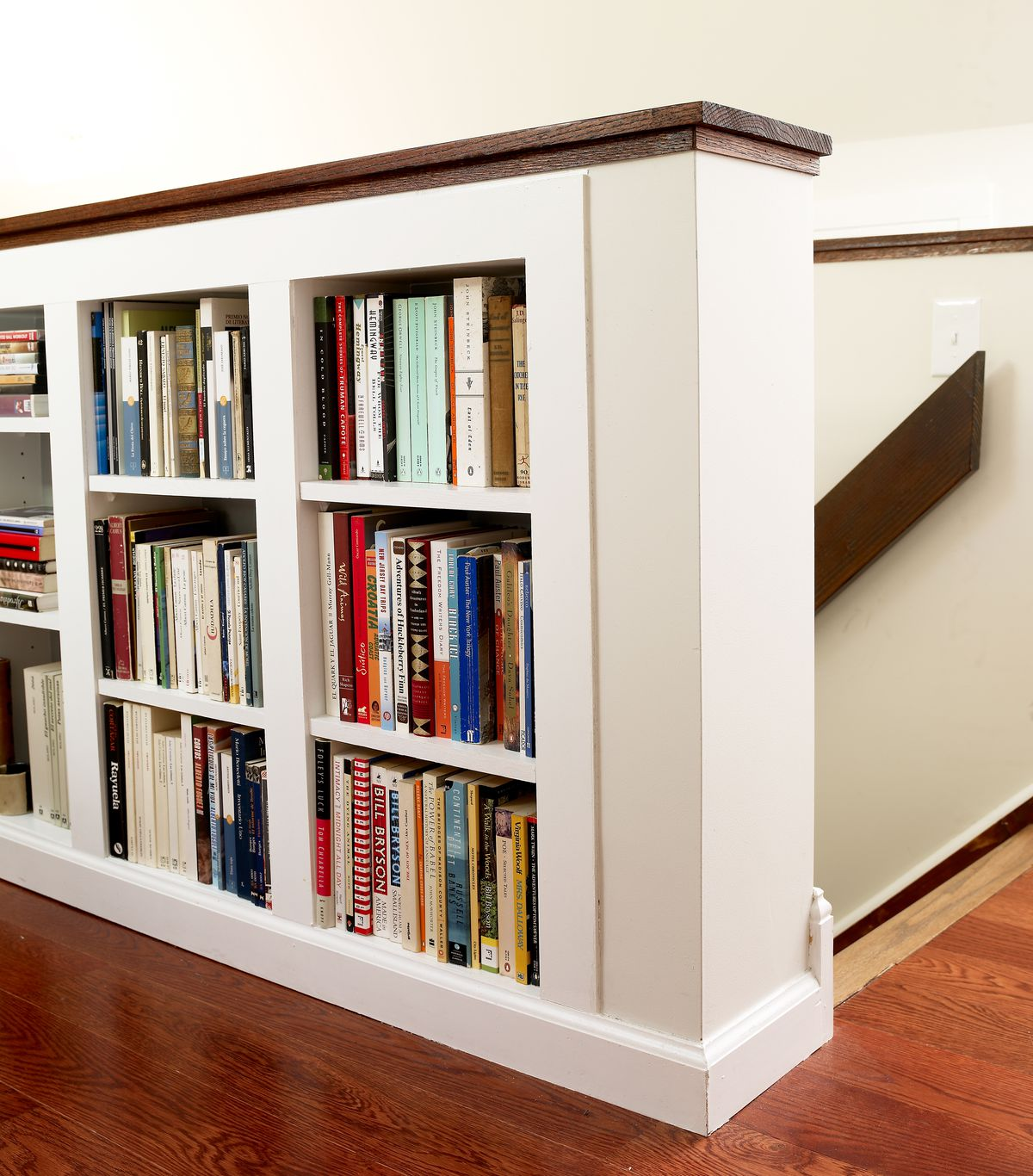 Book storage along the attic staircase.