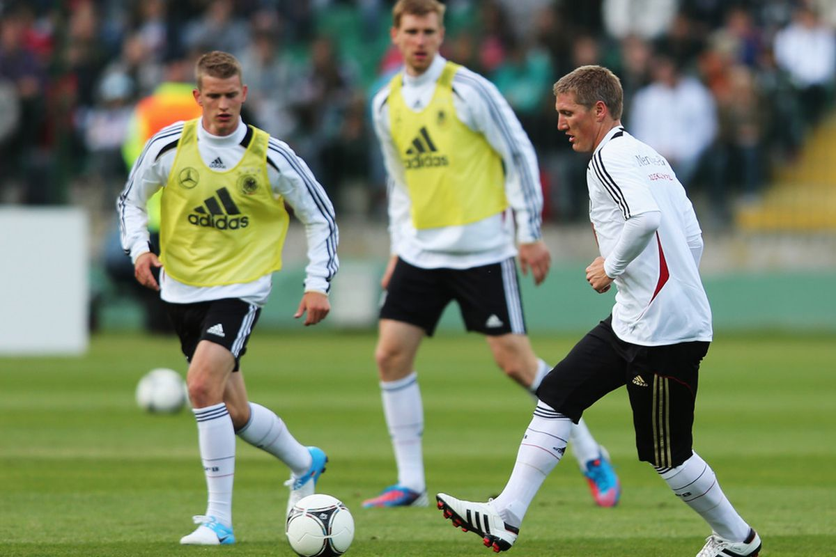 GDANSK, POLAND - JUNE 04:  Bastian Schweinsteiger (R) of Germany controls the ball during a Germany training session at Lechia Gdansk stadium on June 4, 2012 in Gdansk, Poland.  (Photo by Joern Pollex/Bongarts/Getty Images)