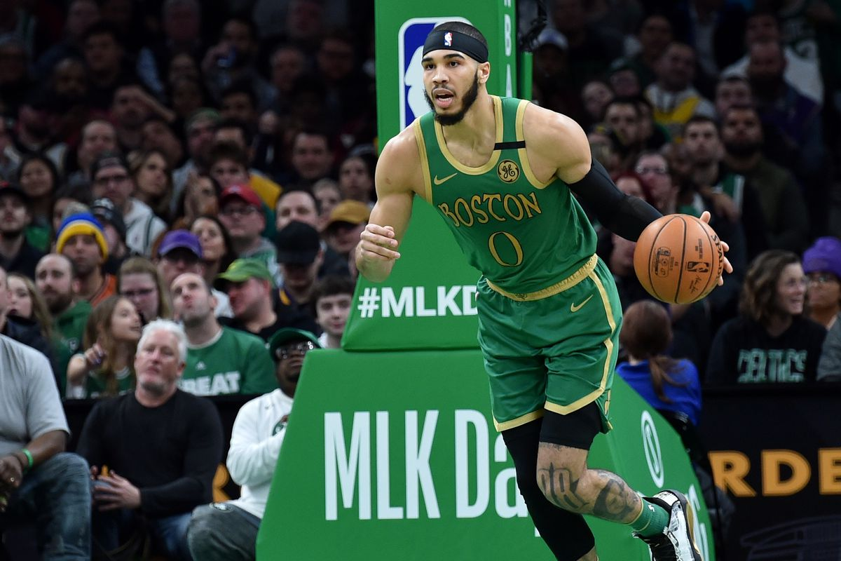 Boston Celtics forward Jayson Tatum brings the ball up court during the second half against the Los Angeles Lakers at TD Garden.