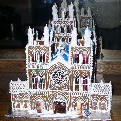 Gingerbread cathedral with colorful windows.