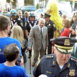 """Police clear the crowd (including Big Bird?) so Mayor Menino may make his address. """"This one's a special one,"""" he would later say."""