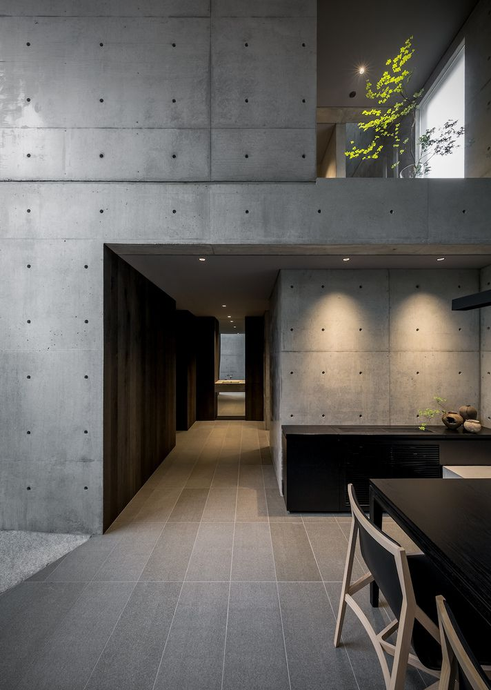 Dining room table in concrete-walled room