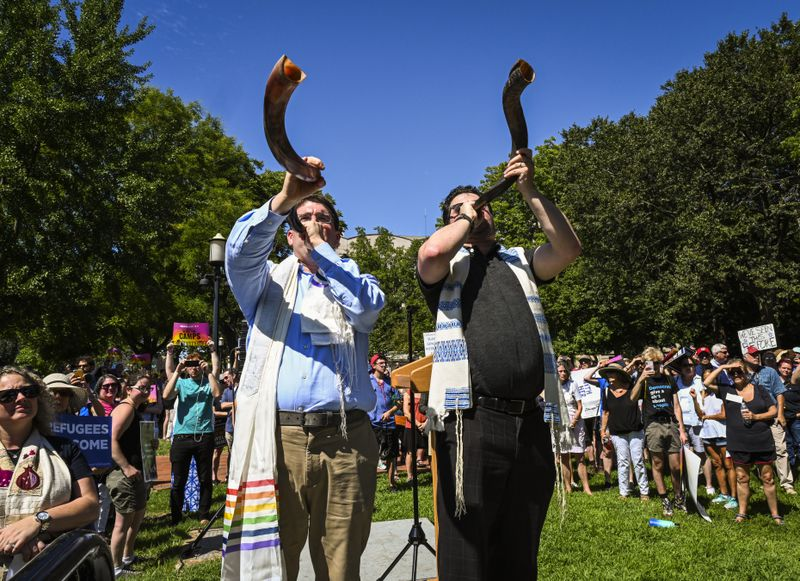 Rabbi Joshua Fixler (right) and Cantor Jason Kaufman, face the White House and blow the shofar.