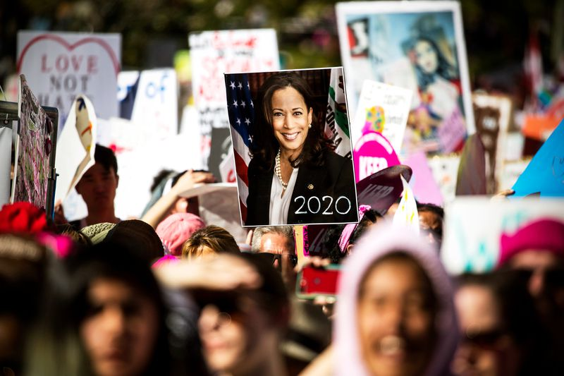 A person holds a poster of US Sen. Kamala Harris as people take part in the annual Women's March on January 19, 2019, in Los Angeles, California.