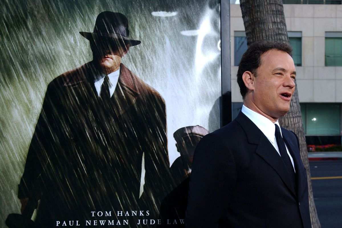 US actor Tom Hanks laughs as he arrives at the Los
