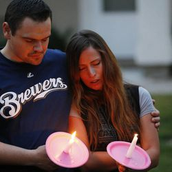 Friends gather during a candle light vigil in Logan Thursday, July 10, 2014. Ronald Lee Haskell, a recent Logan resident, has been charged with multiple counts of capital murder in a shooting in Texas. Haskell and his family lived in Logan for several years.
