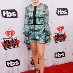 Olivia Holt wears a Genny romper and Schutz shoes.