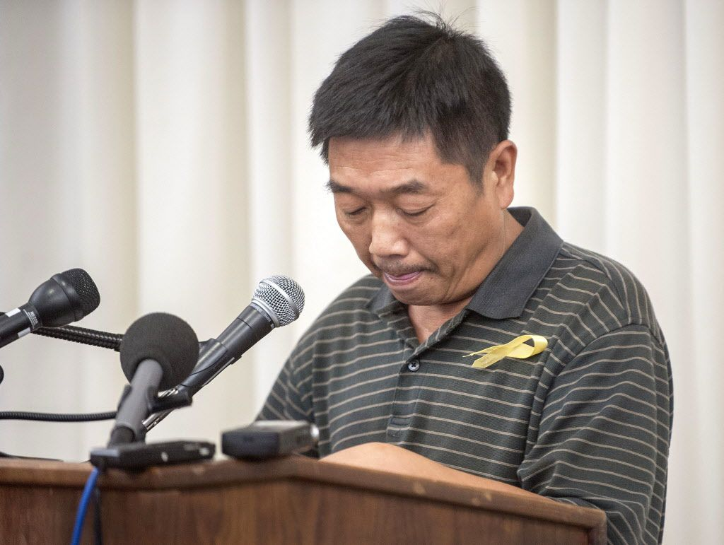 YingYing Zhang's father, Ronggao Zhang, reads a letter he sent to President Donald Trump during a news conference at the I-Hotel in Urbana on Tuesday. | Rick Danzl/News-Gazette via AP