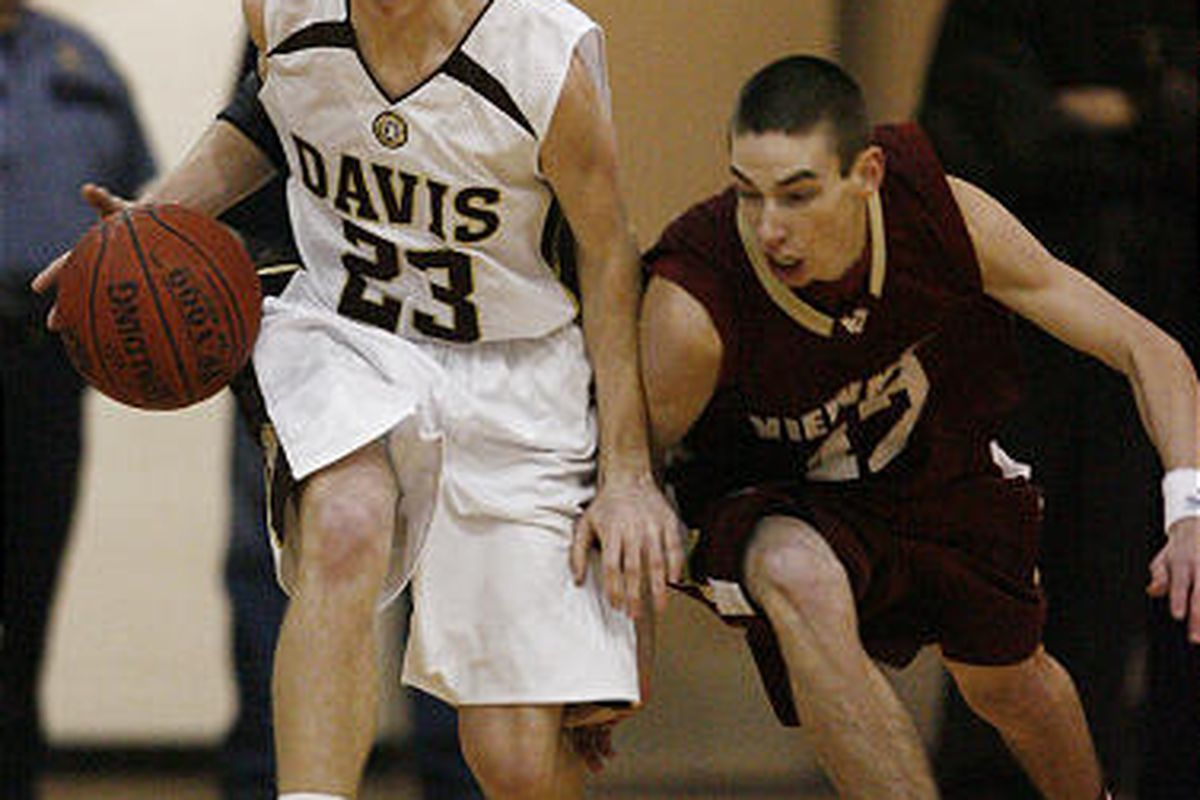 Davis' Chase Flint tries to hold off Davis Emery of Viewmont as they go for a loose ball.