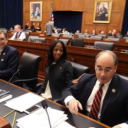 Rep. French Hill, R-Ark., Rep. Mia Love, R-Utah and Rep. Bruce Poliquin, R-Maine, attend a Financial Services Committee meeting at the U.S. Capitol in Washington, D.C., on Tuesday, Dec. 8, 2015.
