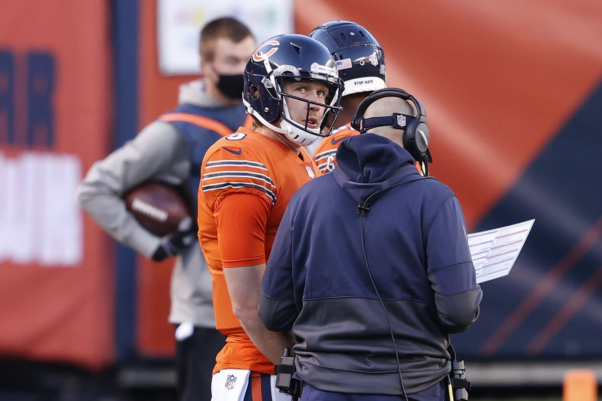 Nick Foles and Matt Nagy discuss a play on the sideline against the Colts.