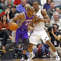 Sun's Michael Redd drives on Utah's Derrick Favors as the Utah Jazz are defeated by the Phoenix Suns 107-105 as they play NBA basketball Wednesday, April 4, 2012, in Salt Lake City, Utah.