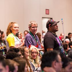 People stand in line waiting to ask the Archie Comics panel questions.