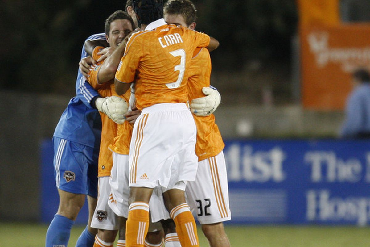 HOUSTON, TX - AUGUST 20: Calen Carr #3 of the Houston Dynamo celebrates with teammates the Dynamo's 3-2 victory over Real Salt Lake at Robertson Stadium on August 20, 2011 in Houston, Texas.  (Photo by Eric Christian Smith/Getty Images)