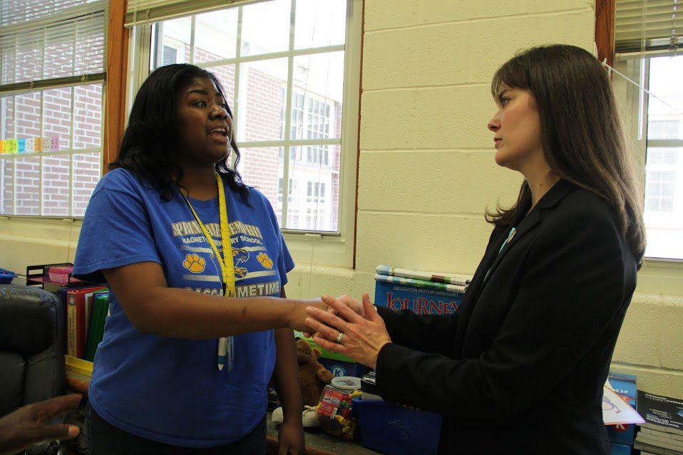 Kindergarten teacher Dana Donelson talks with McQueen during a visit to her classroom.