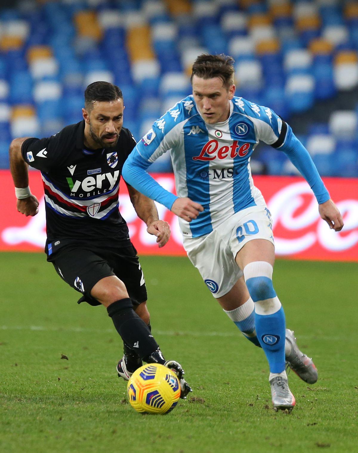 Napoli's Polish midfielder Piotr Zielinski fights for the...