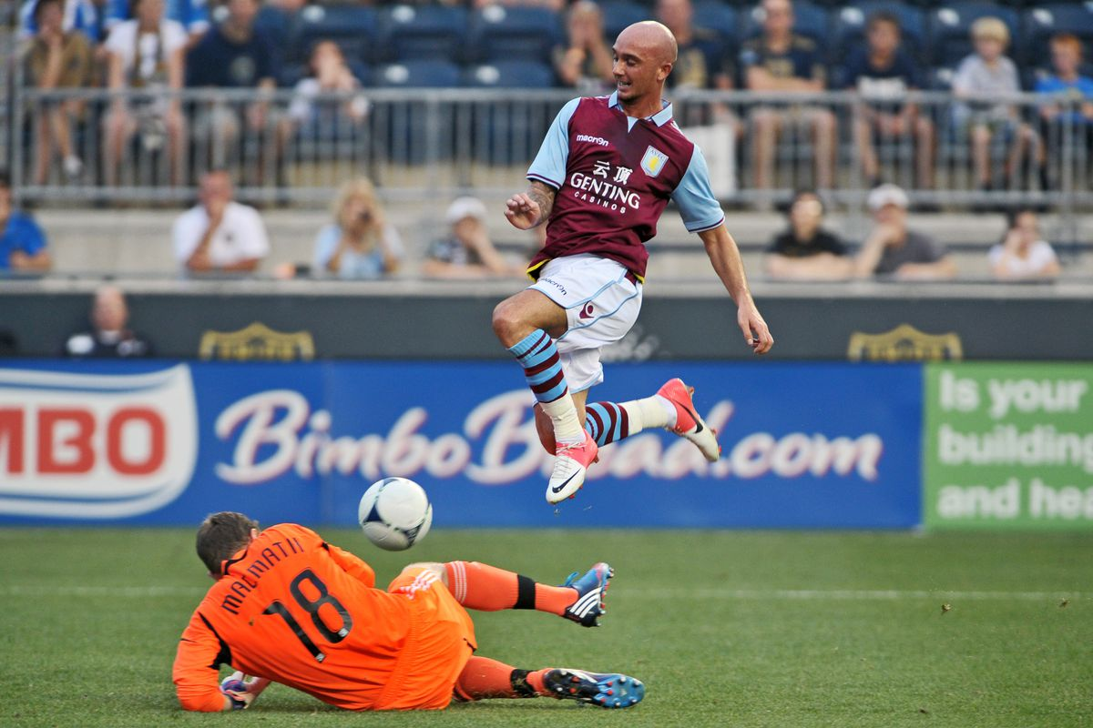 CHESTER, PA - JULY 18: Goalkeeper Zac MacMath #18 of the Philadelphia Union makes a save on a breakaway by Stephen Ireland #7 of Aston Villa at PPL Park on July 18, 2012 in Chester, Pennsylvania. (Photo by Drew Hallowell/Getty Images)