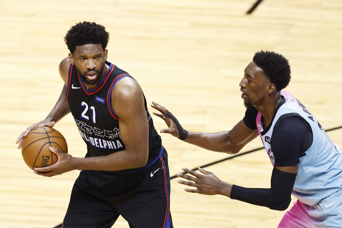 Joel Embiid #21 of the Philadelphia 76ers is defended by Bam Adebayo #13 of the Miami Heat during the first quarter at American Airlines Arena on May 13, 2021 in Miami, Florida.