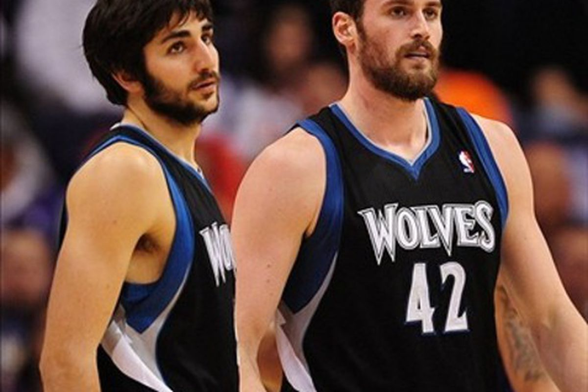Mar. 1, 2012; Phoenix, AZ, USA; Minnesota Timberwolves forward Kevin Love (right) and guard Ricky Rubio against the Phoenix Suns at the US Airways Center. The Suns defeated the Timberwolves 104-95. Mandatory Credit: Mark J. Rebilas-US PRESSWIRE