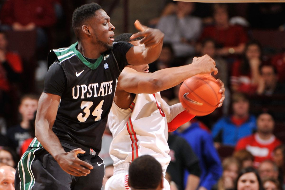 COLUMBUS, OH - DECEMBER 14:  Babatunde Olumuyiwa #34 of the South Carolina-Upstate Spartans attempts to grab a rebound against the Ohio State Buckeyes on December 14, 2011 at Value City Arena in Columbus, Ohio.  (Photo by Jamie Sabau/Getty Images)
