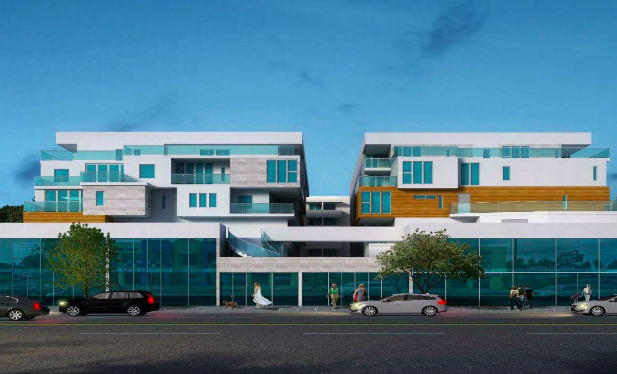 The exterior of Reseda complex in Reseda, California. The facade has blue glass windows and a combination of wood walls and white painted walls.