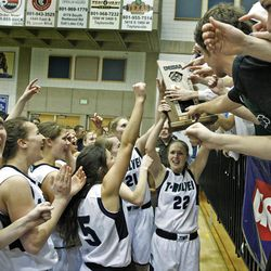 Timpanogos celebrates as Timpanogos High School defeats Springville High School 62-47 to win the 4A Girl's Championship basketball game Saturday, Feb. 25, 2012, in Taylorsville, Utah.