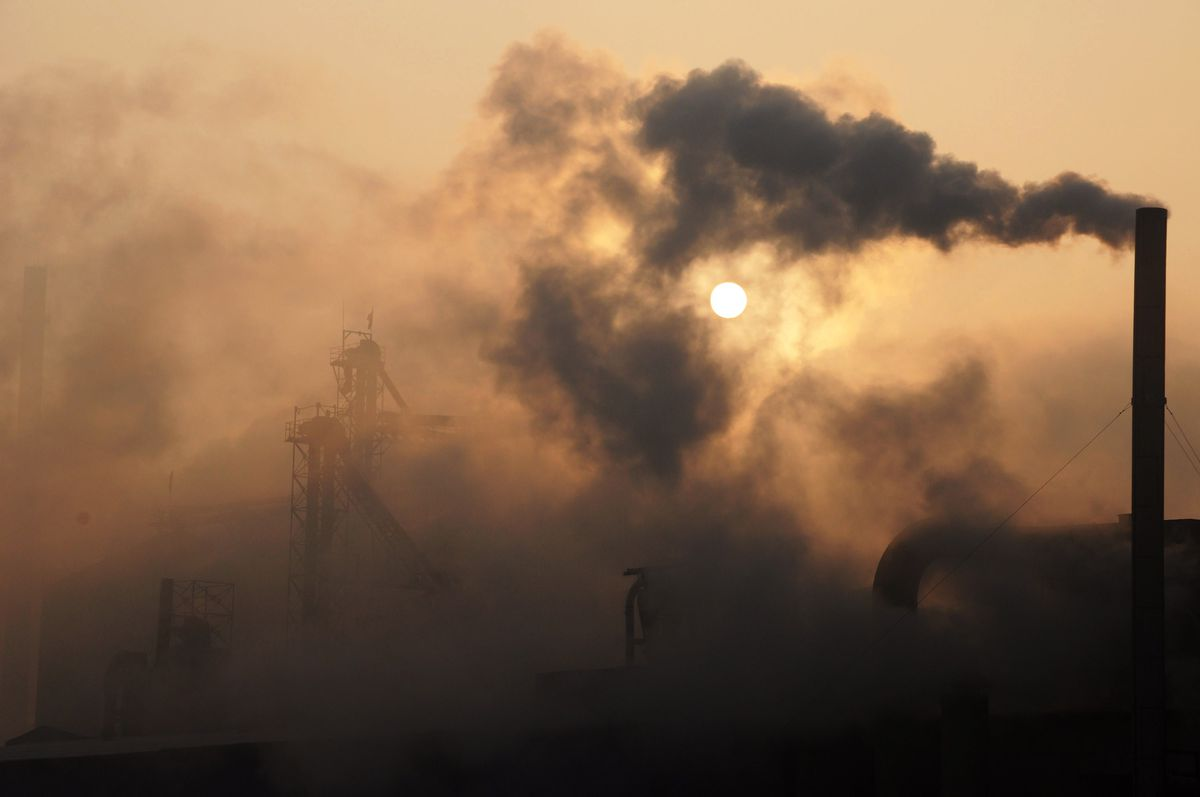 A 2013 photo shows a cement factory releasing heavy smoke in eastern China