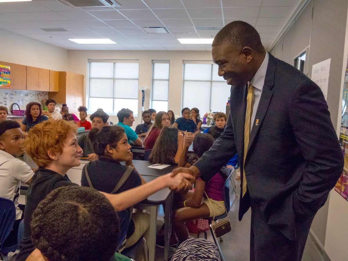 Shawn Joseph greets students in Nashville, where he has been director of schools since 2016.