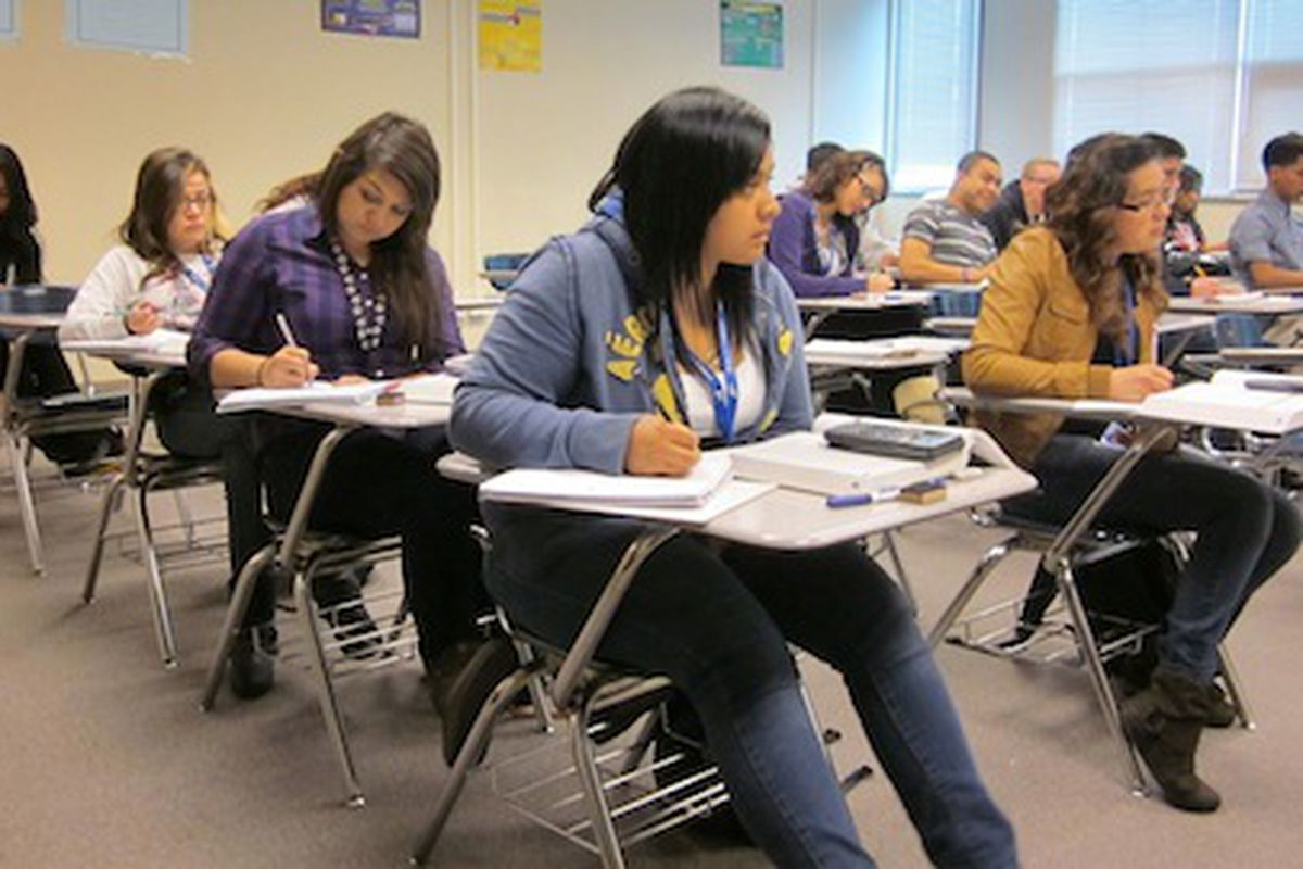 Students work on algebra problems in a college-level course at Hinkley High School in Aurora.