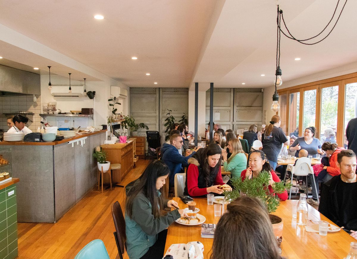 A cafe dining room filled with seated customers