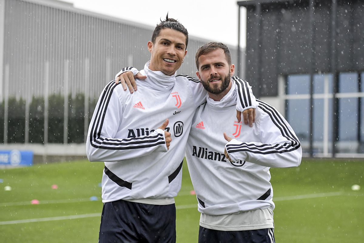 Juventus players Cristiano Ronaldo and Miralem Pjanic during a training session at JTC on June 08, 2020 in Turin, Italy.