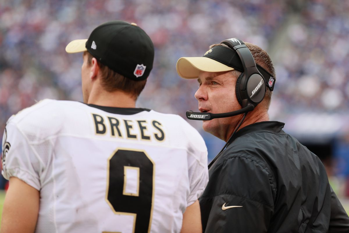 EAST RUTHERFORD, NJ - SEPTEMBER 18:  Quarterback  Drew Brees #9 of the  New Orleans Saints talks with head coach Sean Payton as they take  on  the New York Giants during the second half at MetLife Stadium