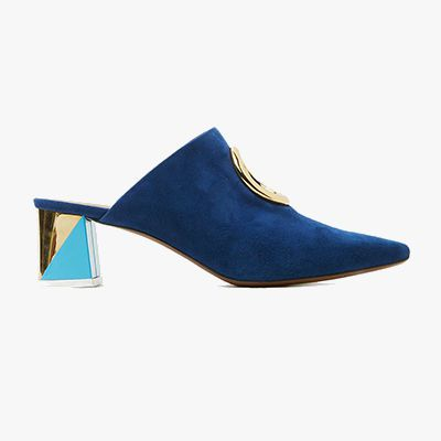 Bold blue mule with gold hardware detailing and multi-textured heel.