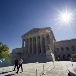 Supreme Court police officers walk on the plaza in front of the Supreme Court in Washington, Tuesday, April 28, 2015. The Supreme Court heard historic arguments in cases that could make same-sex marriage the law of the land.